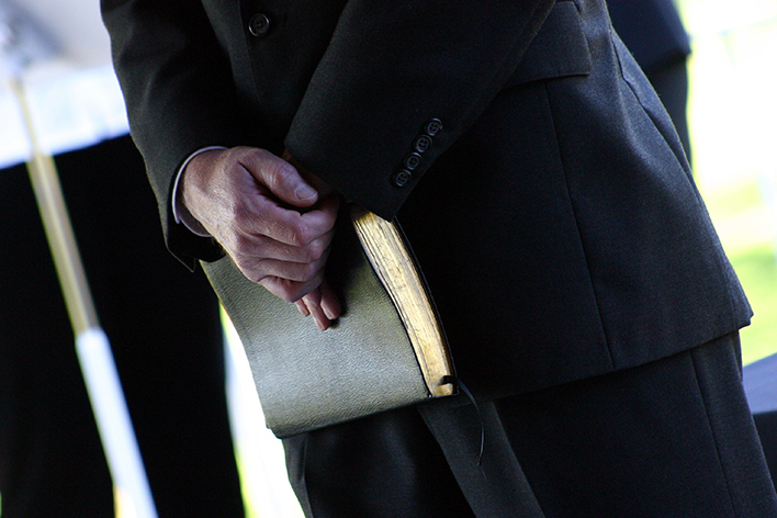 minister holding Bible